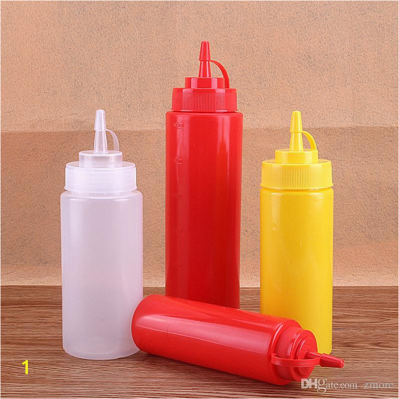 Plastic squeeze bottle dispenser with cap Used as sauce oil vinegar ketchup mustard mayonnaise dispenser Great for restaurant and home kitchen use