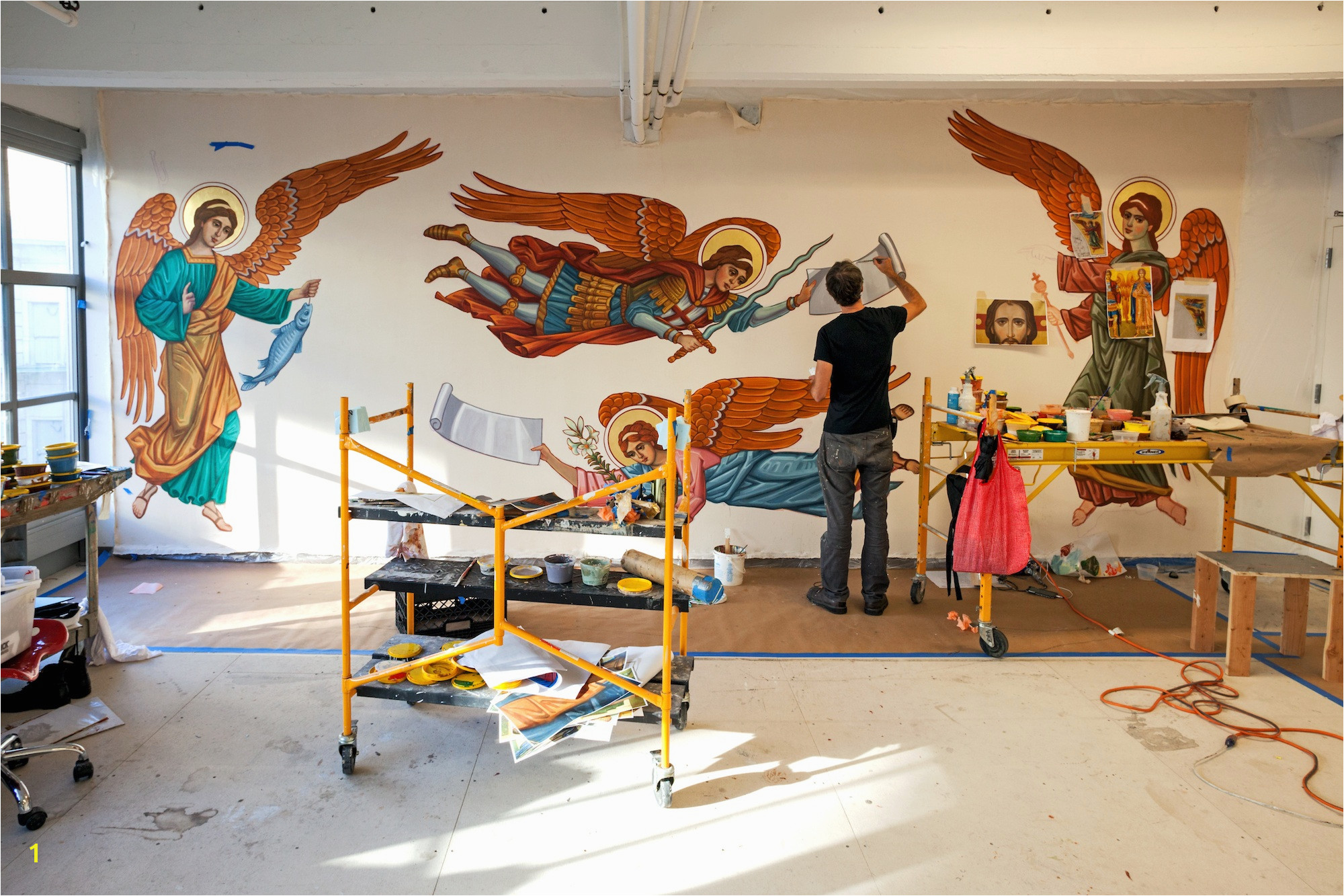 Artists paint religious figures for the Sacred Heart Cathedral in Knoxville