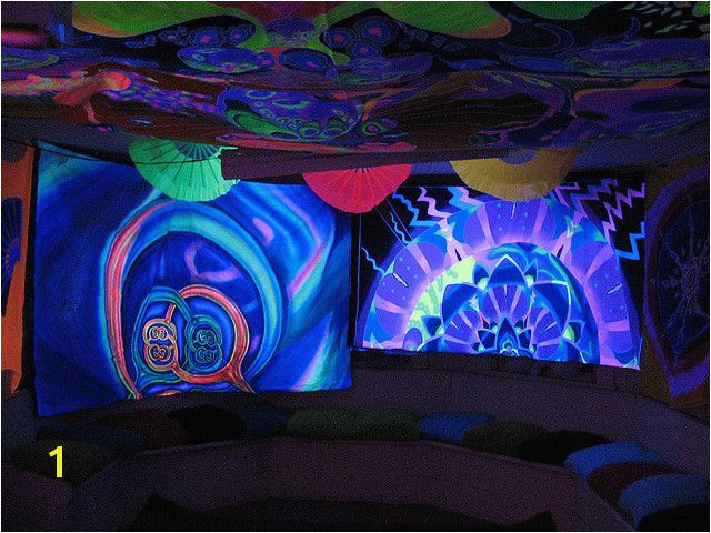 We are going to hang black sheets on the walls and encourage our guests to create art with glowpaint