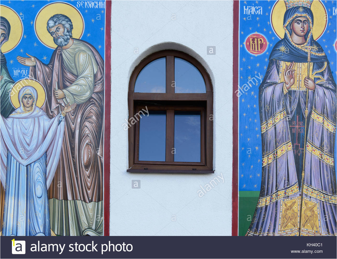 New murals on wall of new church Romania Stock Image