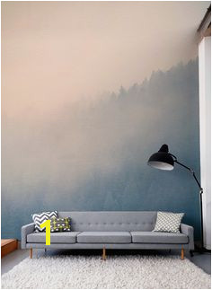 Gaze across the treetops with the beautifully hazy forest wall mural Soft pastels colour make