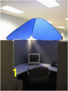 CubeShield™ blocks out bothersome overhead lights while providing added personalization and privacy to office cubicles