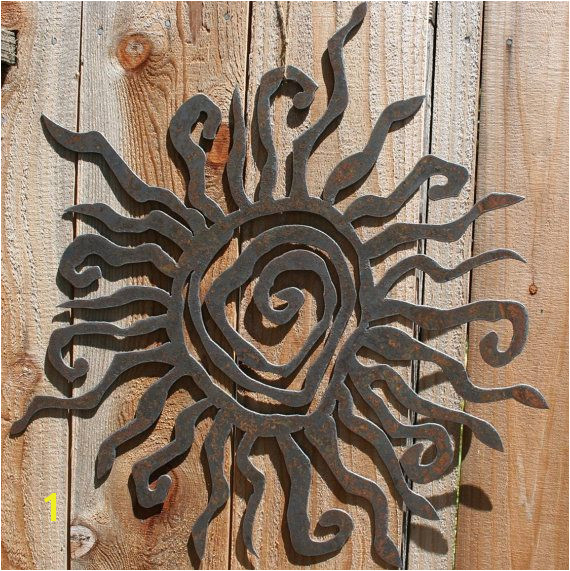 This rustic sun measures 30 in diameter and is quite the statement piece Cut from recycled steel no two pieces look alike Hang it outside in your garden
