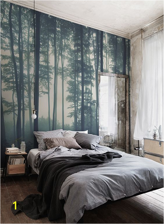 Discover calming interior design with a moody forest wallpaper Featuring a sea of trees in deep misty hues this wallpaper can transform any room into a