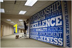 Trust the local sign experts at Pensacola Sign to encapsulate your space with bold branded environmental graphics wall murals and architectural signs and