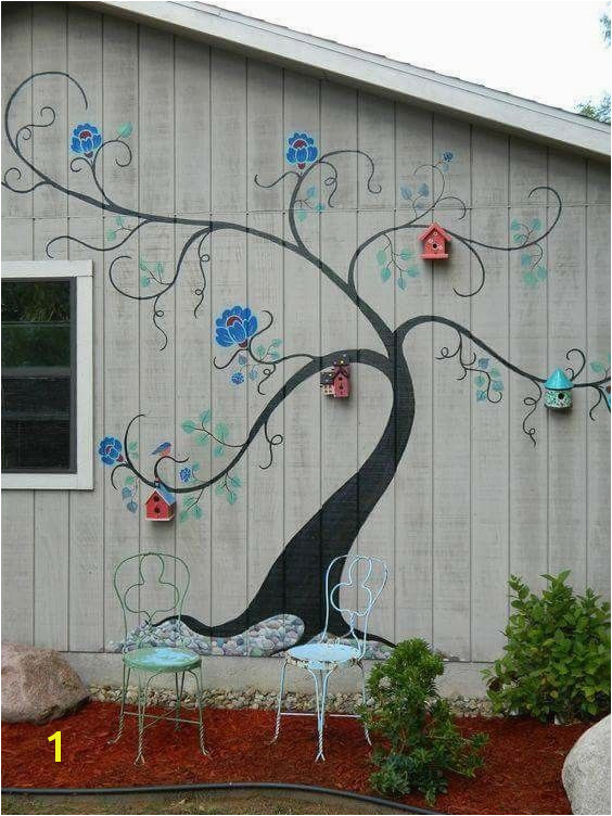 Tree mural brightens exterior wall of outbuilding or home Painted Shed Painted Garage Walls