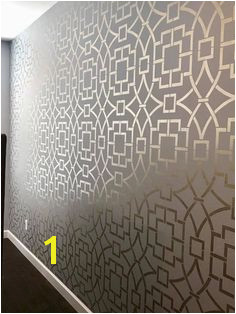 A DIY metallic stenciled bedroom accent wall using the Tea House Trellis Wall Stencil from Cutting