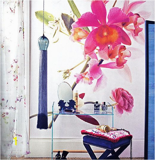 A plain white wall can be brought to life with an oversized floral mural Giving an instant contemporary update a large mural such as this can make a room