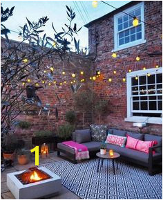 Courtyard garden with outdoor cinema fire pit festoon lights