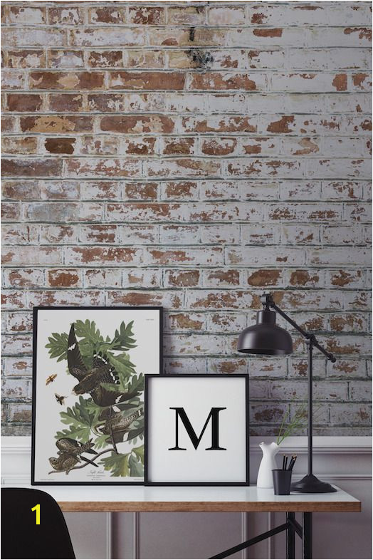 A realistic brick wallpaper like this from Murals Wallpaper can give your home that rough luxe look with no fuss at hall