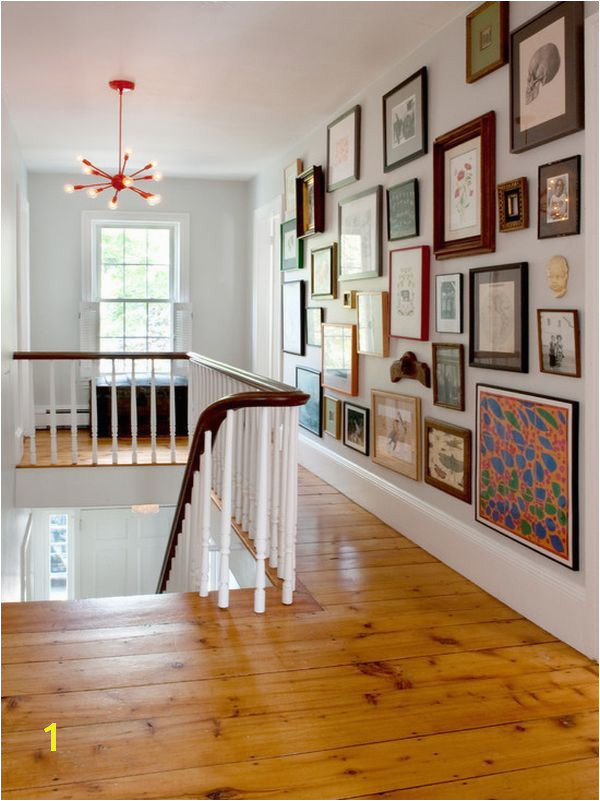 "Use an eclectic mix when filling a hallway wall This collection is easier to ""see"" than a wall of uniform shapes and matching frames"