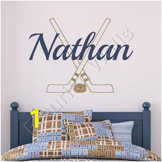 Items similar to Hockey Wall Decal Personalized With Name Hockey Sticks And Hockey Puck Athletic Sports Vinyl Wall Decal Boys Room Wall Art BN027 on Etsy