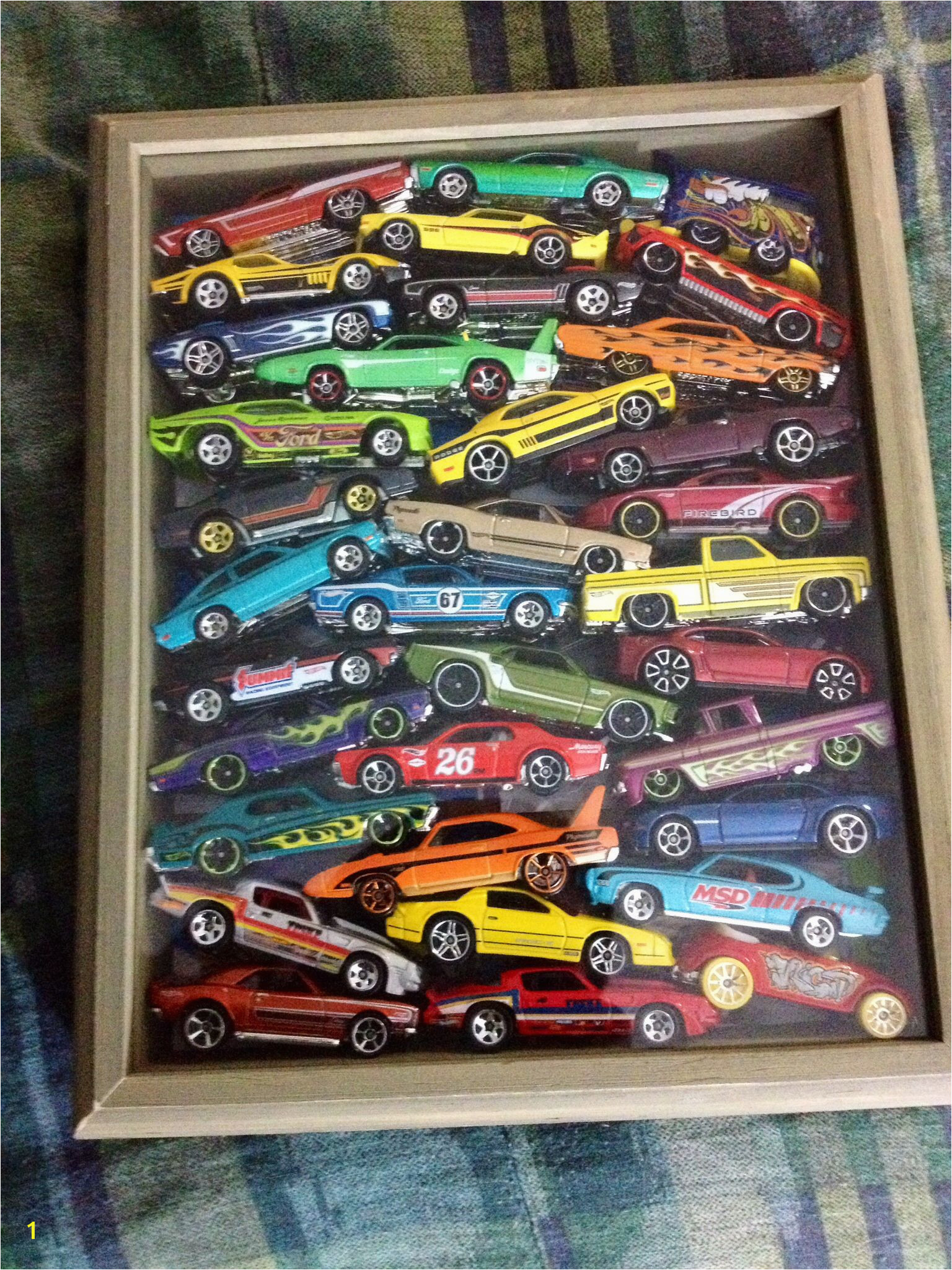 8x10 shadow box loaded with Hot Wheels good way to store and display those cars that got unpackaged to play with hotwheels