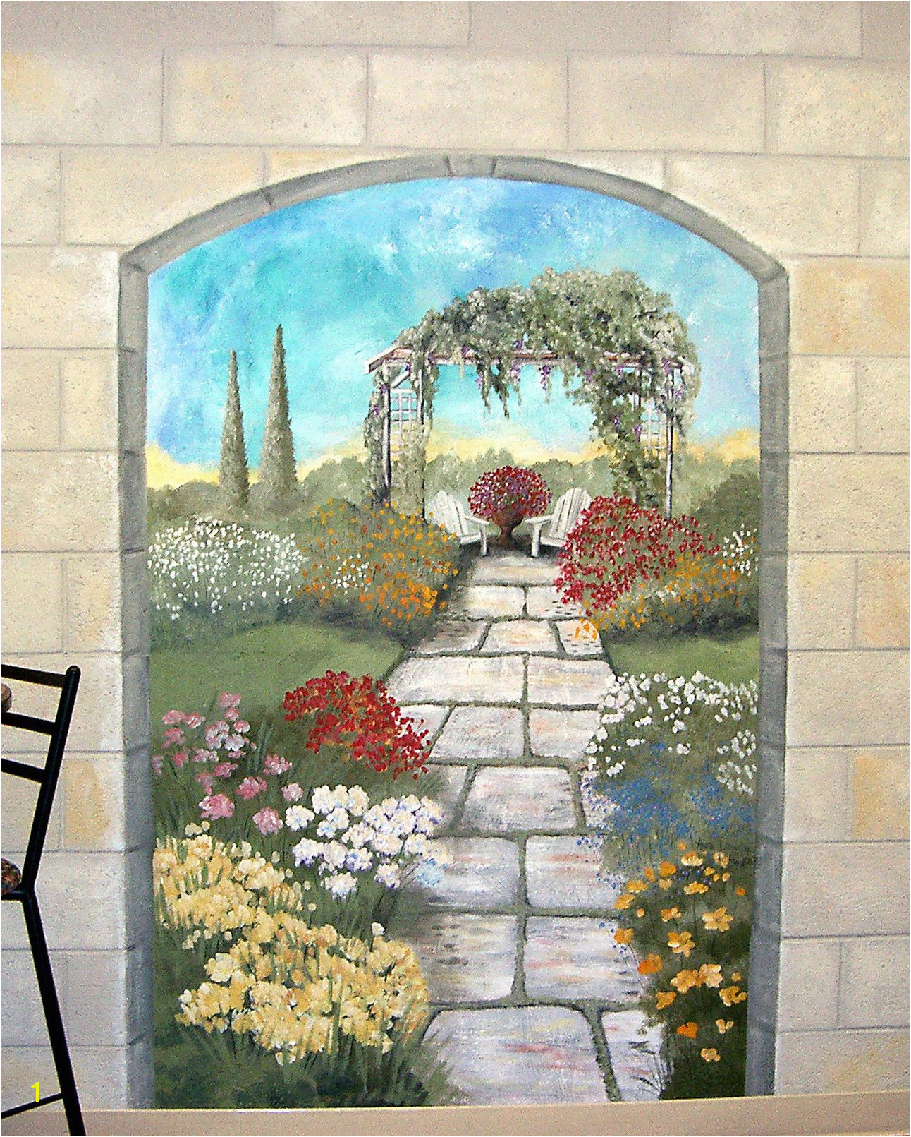 Garden mural on a cement block wall Colorful flower garden mural with terrace
