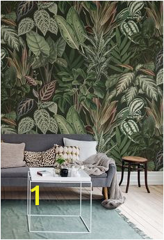 Big green leaves on a dark background Jungle inspired wallpaper Mischievous Monkeys Lush