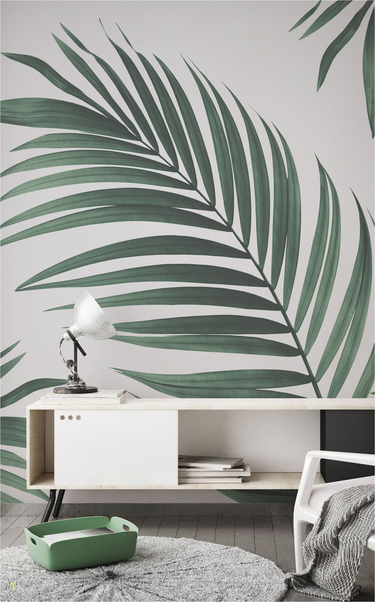 Falling in love with greenery This jungle wallpaper is another great way to incorporate life into your home Lovely faded green tones of the palm against a