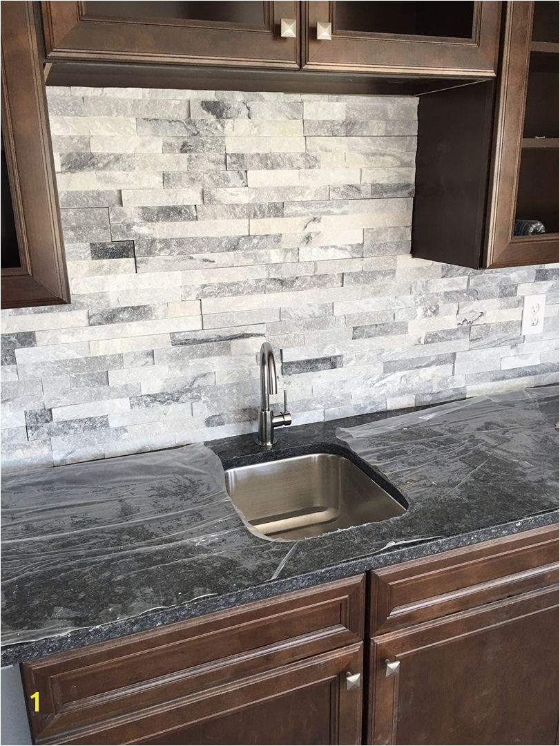Stacked stone is a great wet bar backsplash