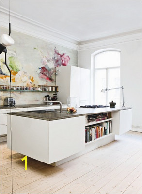 Interesting kitchen island with a modern feel and a wall mural