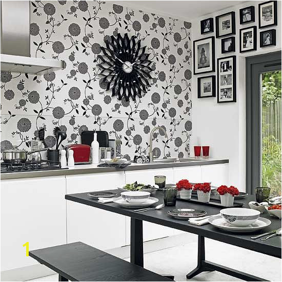 Not loving the wall paper but I love the black and white with the red accent and of course the picture frames
