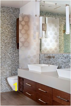 With very little pattern in this otherwise minimalist bathroom the glass adds detail and character Glass panies have several artisanal glass options