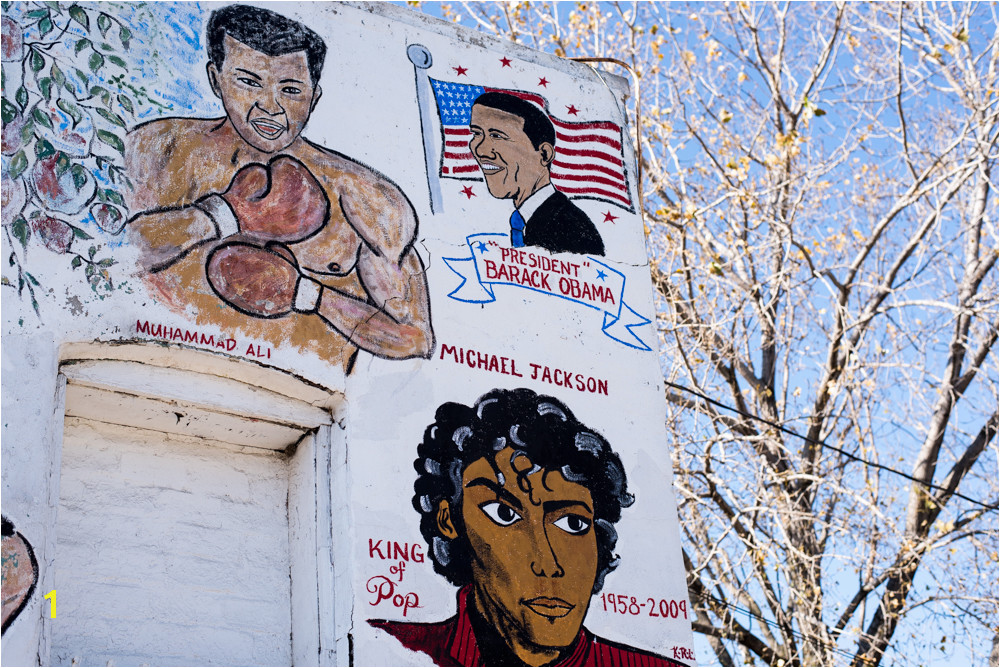 a newer corner of the Wall of Respect President Obama s portrait is flanked by depictions of Muhammad Ali and Michael Jackson