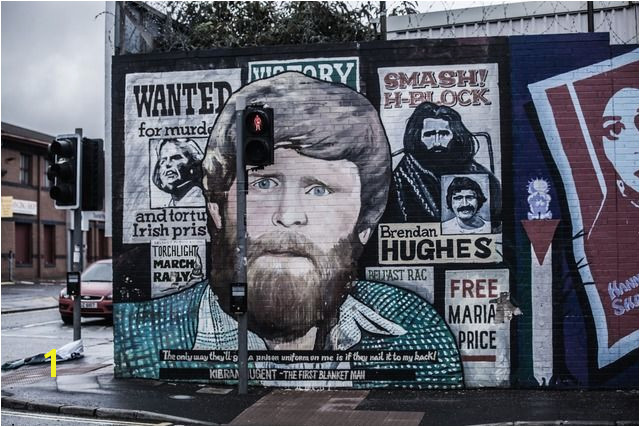 A symbol of Belfast mural in Belfast Northern Ireland depicting the region s past and present political and religious divisions