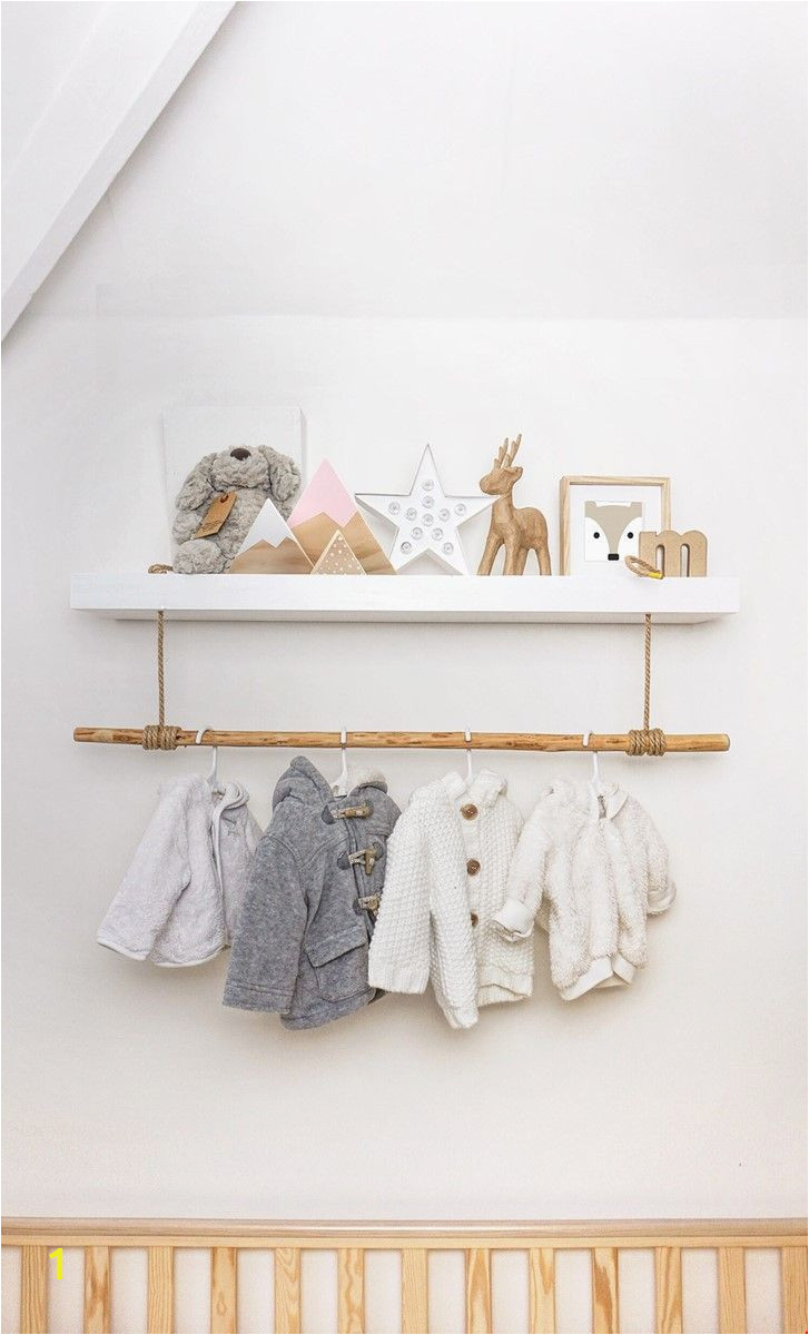 Hack of a standard white floating shelf to add a clothes rail for the new nursery