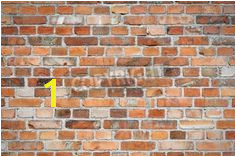 Old weathered red brick wall via MuralsYourWay Brick Wallpaper Mural Orange Brick