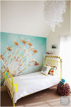 Taya s bedroom features a whimsical wall mural by Zee Longenecker available from Murals Your Way The Incy Interiors bed adds a pop of sunshine