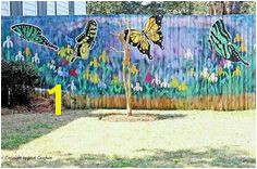Gorgeous butterfly mural on the fence I want to do this so terribly badly Like Drew Barry Moore to a garage in 50 first dates Gardens And Thyme