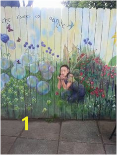 Fairy blowing bubbles in garden mural