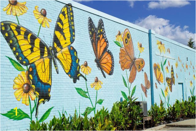 Lovely butterfly mural by artist Chip Wilkinson in South Norfolk on the outside wall of the Portlock Galleries