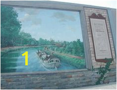 Mural of Erie Canal there are murals throughout the village of Lyons of Erie Flood WallErie