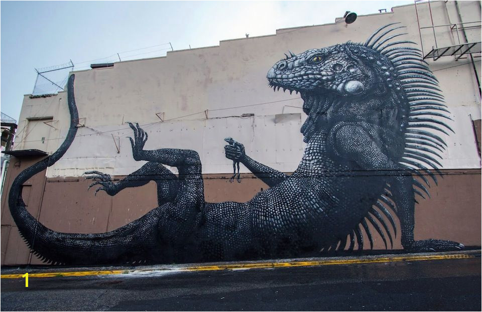 Belgian artist ROA just pleted his latest mural for the Los Muros Hablan Festival in San Juan Puerto Rico The massive mural features an Iguana holdi
