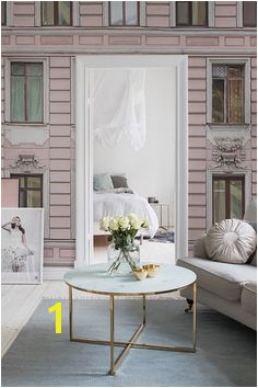 Romantic pink living room with marble table linen howard sofa Architectural facade wallpaper from Rebel Walls AB