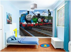 The Thomas the Tank Engine Walltastic is a 12 piece wallpaper wall mural that brings the World of Thomas into your child s room