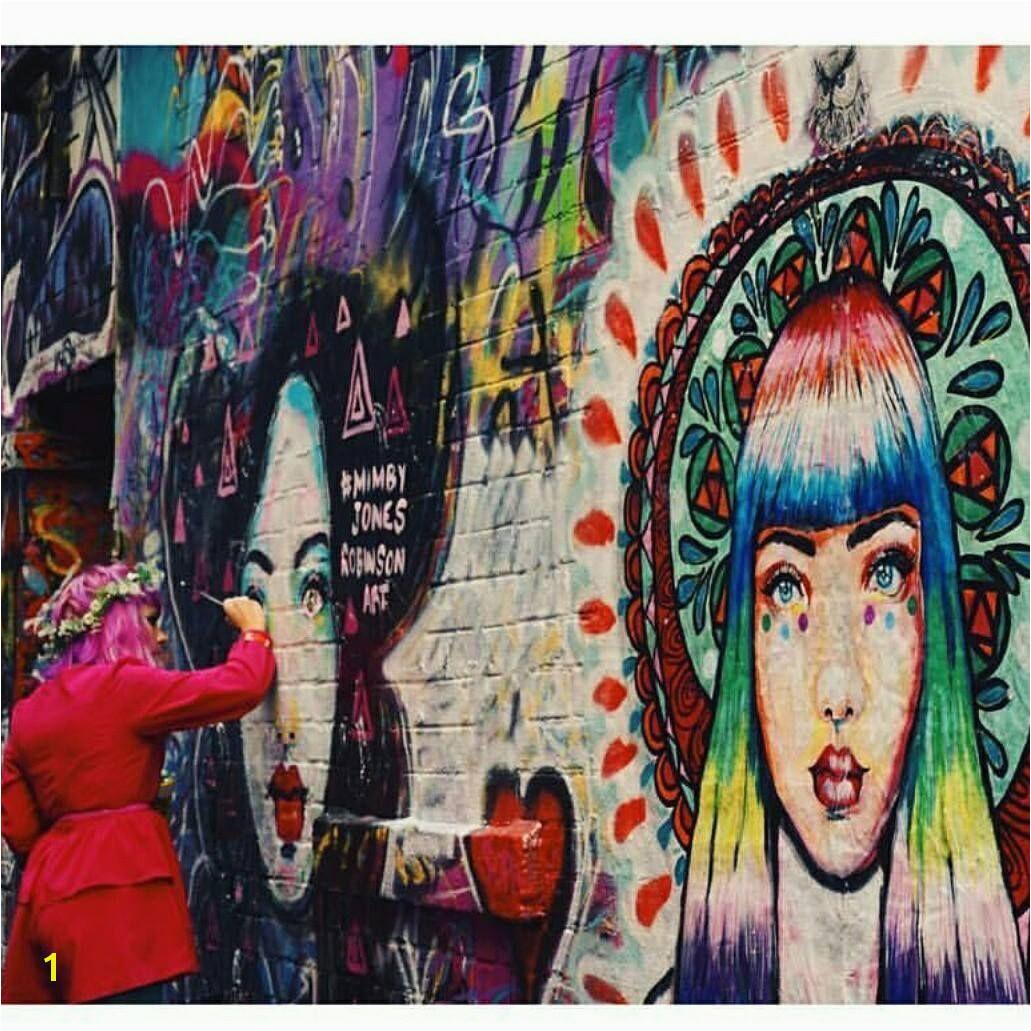 Mimby Jones Robinson painting her Goddess murals in Hosier Lane Melbourne graphy by Sophie Argiriou