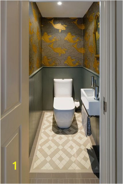 traditional cloakroom with gold fish wallpaper at battersea house
