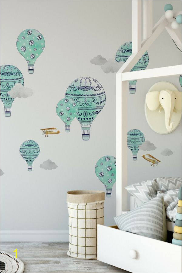 Soar through the clouds on a whimsical hot air balloon or golden biplane These hand painted decals will take your nursery to new heights