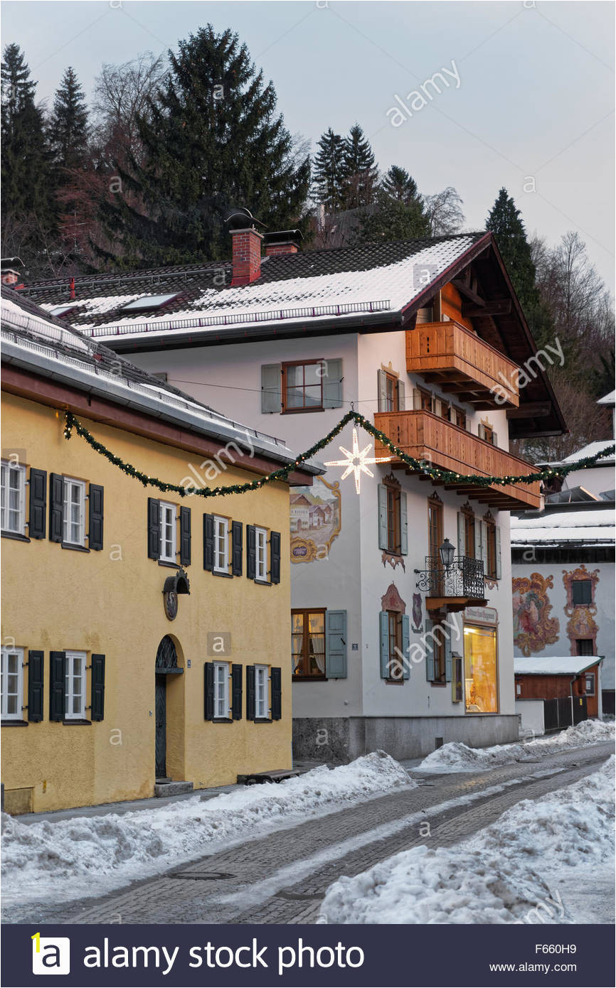 A Building Has A Mural Painted On An Outside Wall Snowy Street Of Garmisch Partenkirchen with Unique Murals On