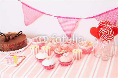dessert table in pink at girls birthday party