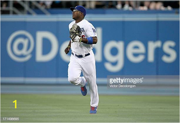 yasiel puig of the los angeles dodgers jogs out the play after making picture id