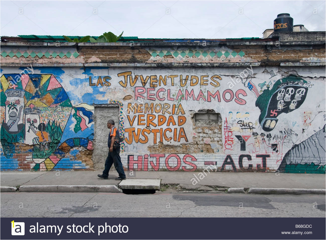 wall in guatemala city covered with political graffity B68GDC