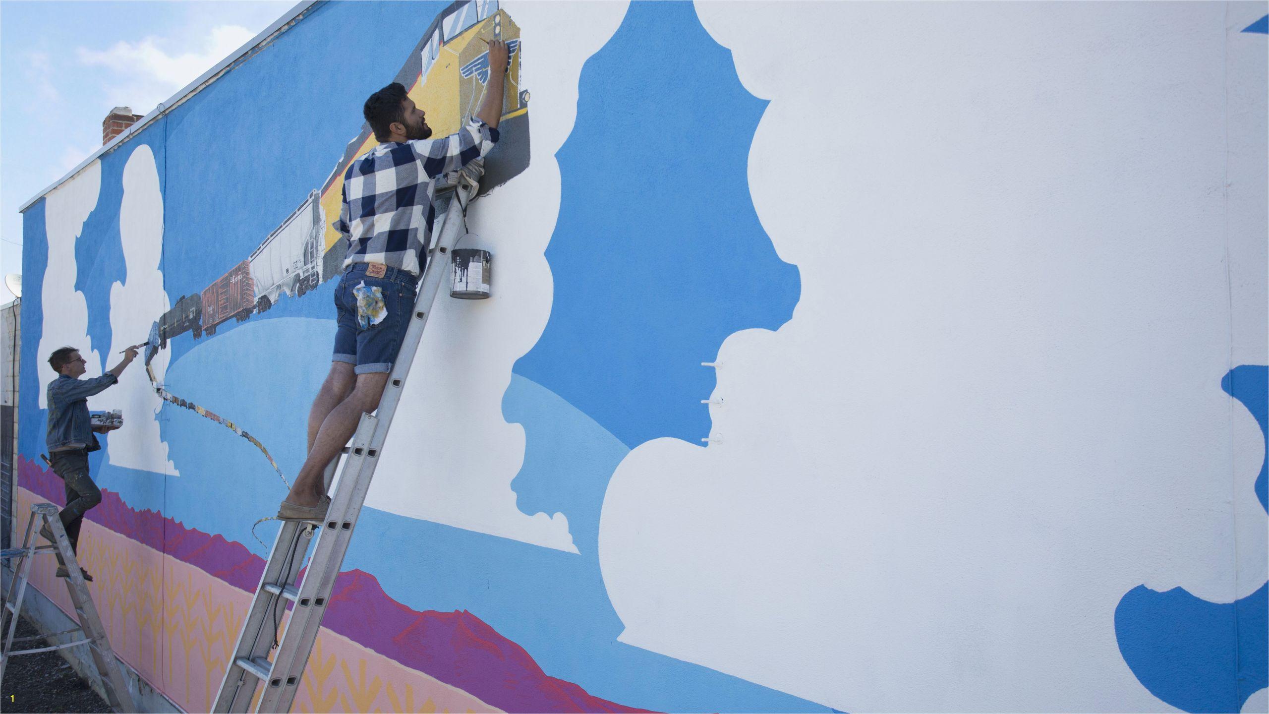 artists painting mural wall fdc5f9b58d5b185b9c4