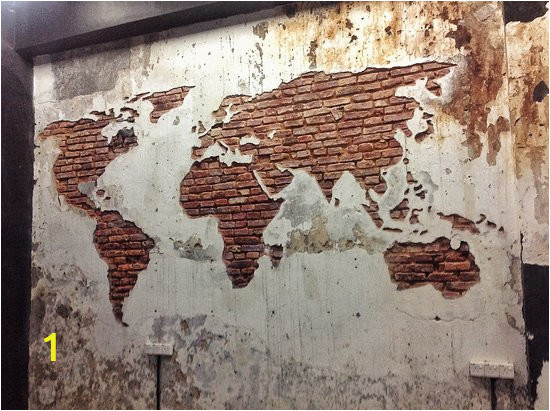 a world map carved into