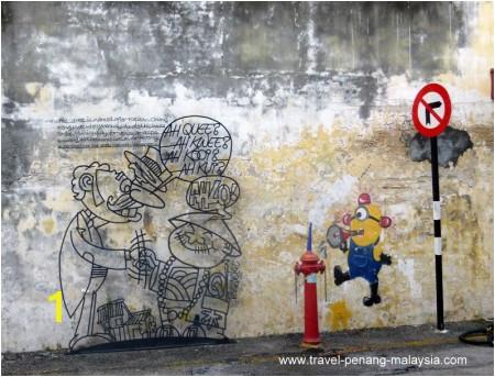 iron wall caricatures penang 1