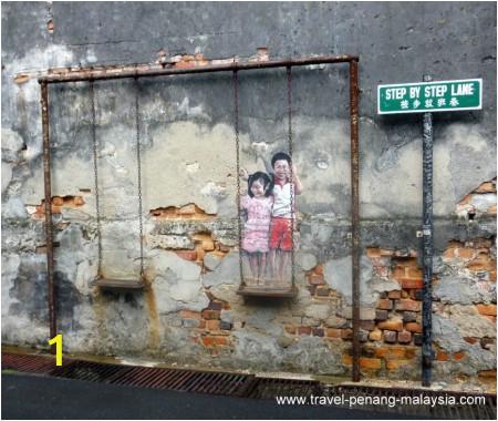 children on swing street art