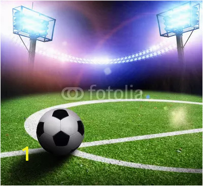 football field with a ball on a stadium with lights and flashes at night webp