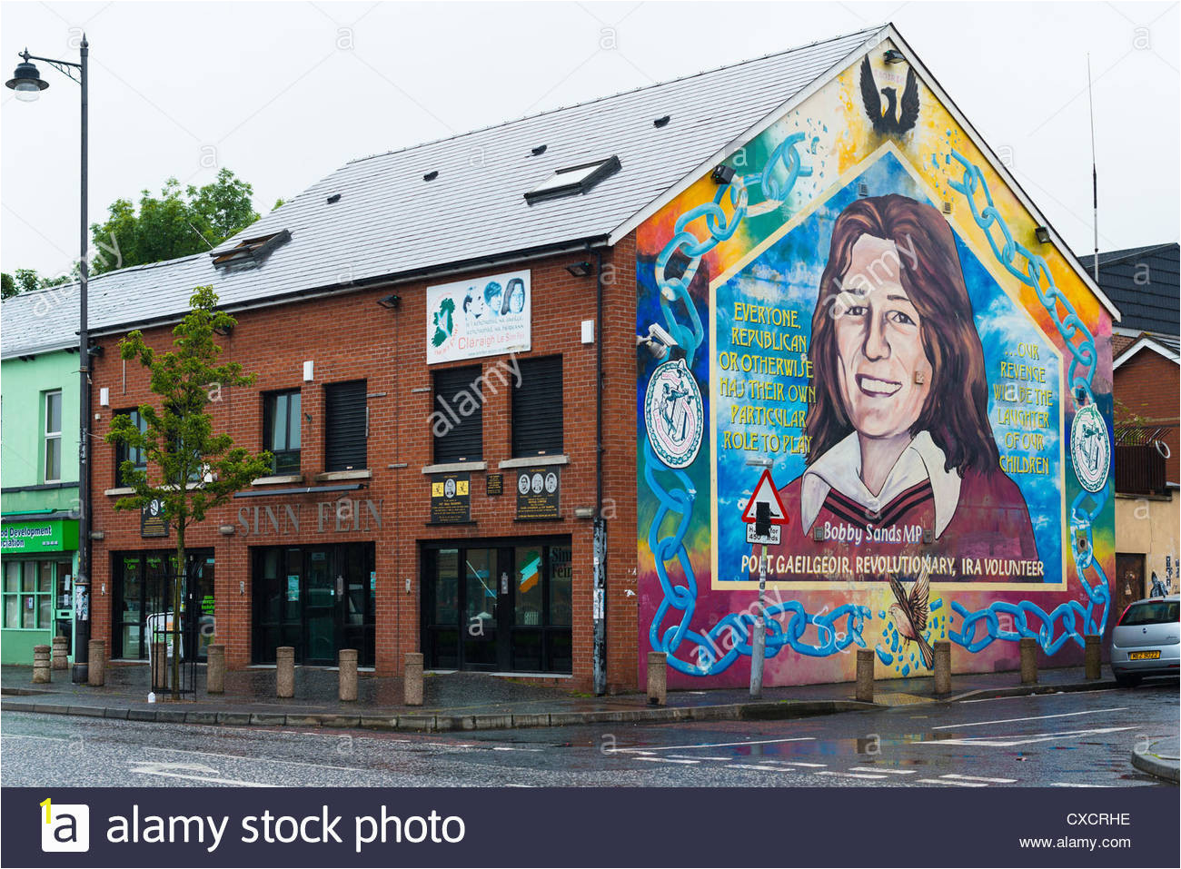 sinn fein constituency office with mural of bobby sand on catholic CXCRHE