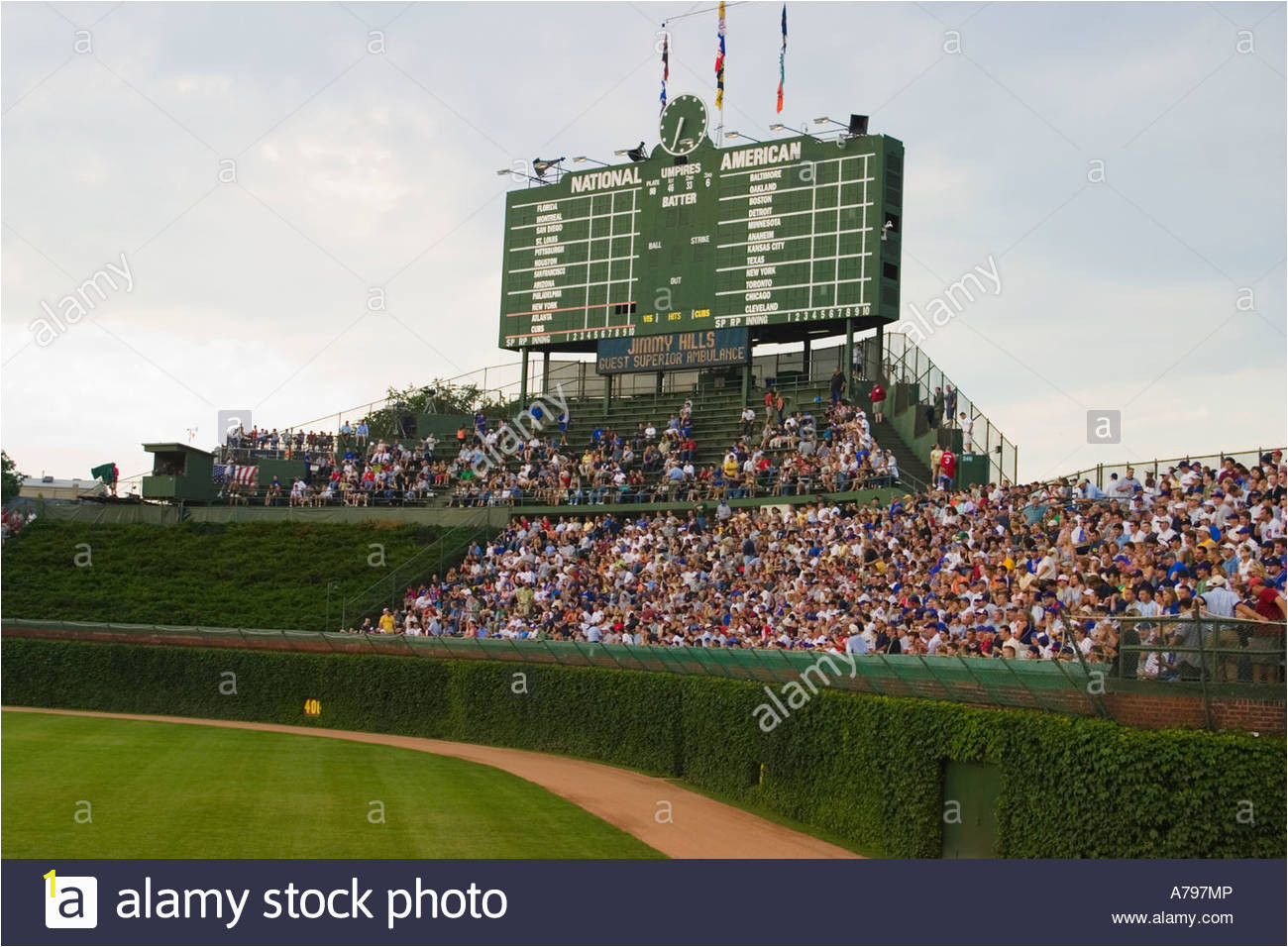 sports chicago illinois night game at wrigley field fans in bleachers A797MP